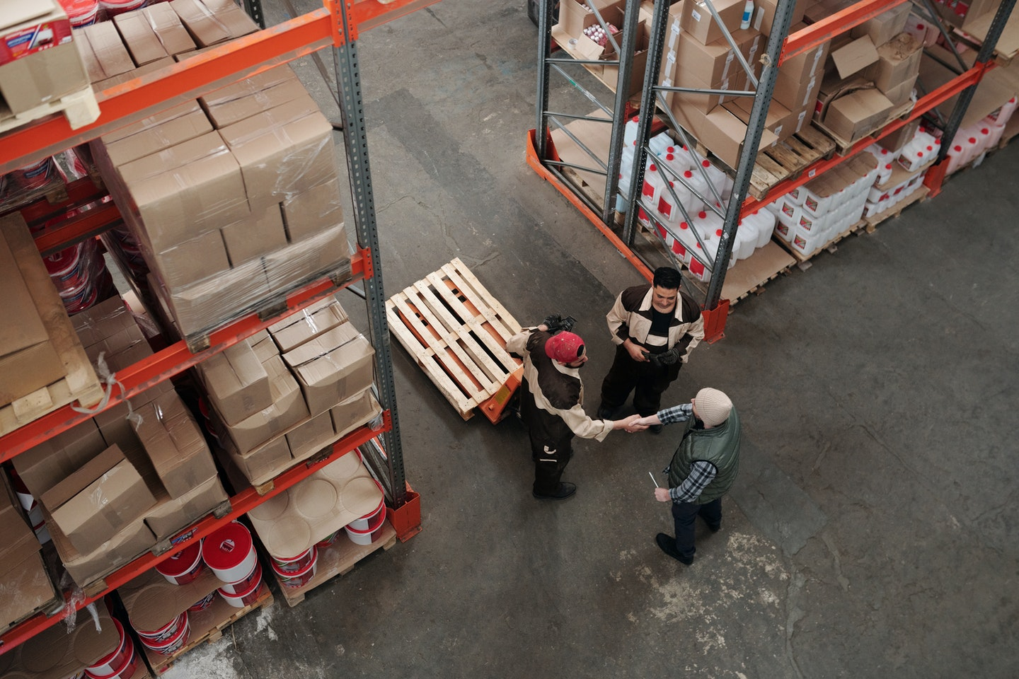 Warehouse workers in storage area